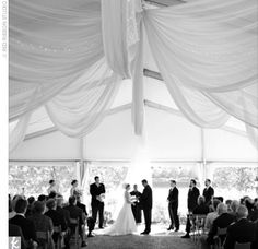 beautiful wedding reception under a tent :)