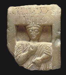 A SOUTH ARABIAN ALABASTER STELE CIRCA 1ST CENTURY B.C./A.D.