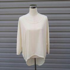 Beige Hi-Lo Top Beige 3/4 Sleeve Hi-Lo Top   This is NWOT Retail. Price Firm Unless Bundled Tops