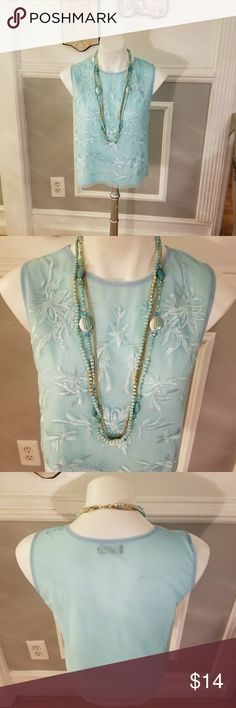 Sleeveless boutique shirt . Sheer light blue Wonderful piece to layer during cooler temperatures. It's classic enough to wear solo during warmer weather. Transitions easily from day to evening. Small size boutique item Tops