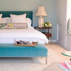 Blumenfeld Interiors - bedrooms - blue walls, blue bedroom walls, wall-to-wall carpet, light carpet, bedroom carpet, turquoise headboard, tu...
