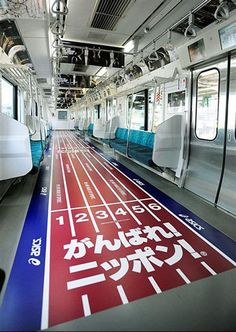 Unique advertising for Asics on Yamanote subway line train. Tokyo, Japan.