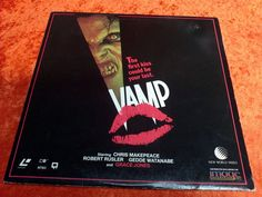 """Vintage Laser Disc. """"Vamp"""" staring Grace Jones. Cult Horror Movie. Image entertainment 1986. Cover is decent with some wear including some edge/ring wear, some left over sticker residue on the upper right corner of cover, some small creases, and a small paper tear on the top middle edge. (Please see photos). Cover is not perfect but still super cool with great graphics. Would look awesome framed a"""