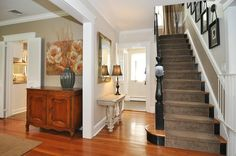 Traditional Staircase with High ceiling, Hardwood floors, Chair rail, Carpet