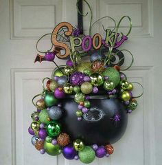 This is a perfect mash of holiday decorations - Christmas ornaments (I assume) with Halloween ornaments. Witch Cauldron Door Hanger -- made by Kathie Whiting (Halloween Diy Halloween Party, Casa Halloween, Halloween 2014, Diy Halloween Decorations, Holidays Halloween, Halloween Treats, Happy Halloween, Halloween Door Wreaths, Halloween Deco Mesh