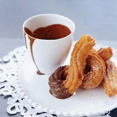 Warm Churros and Hot Chocolate | Chef Andrew Zimmerman grew up eating fluffy donuts in New Jersey, but now he favors churros—hot, crispy fried Spanish crullers. Zimmerman pipes the dough into a ribbed spiral, then coats the churros in crunchy sugar and cinnamon. They're perfect for dipping into hot chocolate.