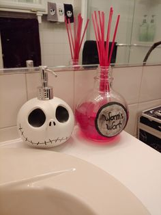 """Jack Skellington soap dispenser purchased from Spirit Halloween. Beware that paint wears off, as you can see in photo. Oil diffuser made from empty/cleaned bottle of Captain Morgan Bombshell. """"Worms Wort"""" hand painted on thick paper and sealed to bottle. Oil and reeds purchased from Walmart for under $5. Nightmare Before Christmas Bathroom"""