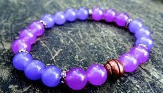 This gorgeous bracelet was made of lavender and purple jade with copper plated bead. Jade is a powerful emotional balance, nurturing and bringing peace and purity into your life, removing negative thoughts and energy. It also symbolizes good fortune, prosperity, love and guards against accident and misfortune.