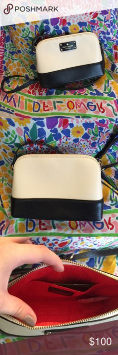Kate Spade Wesleyan leather cross body Near perfect condition white and black cross body bag! Used once, still has care card. Adjustable black strap. Beautiful red interior. Gold zipper with long black leather zipper pull. Let me know if you would like more pictures! :) kate spade Bags Crossbody Bags