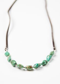 Turquoise Nugget Choker | This gorgeous and simple necklace is hand strung with small genuine Turquoise nuggets and metal rounds. Finished off with a dark brown deerskin lace strap, featuring an adjus