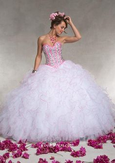 Strapless ball gown quinceanera dress for special event. Sweetheart neckline outlined by pink ribbon on corset bodice with basque waist, ball gown skirt with luxury ruffles finishes off the look, lace up back. Matching bolero jacket. Sequin corset bodice.