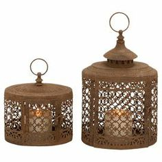 "Set of 2 iron candle lanterns with openwork details.  Product: Small and large lanternConstruction Material: IronColor: BrownAccommodates: (1) Candle each - not includedDimensions: Small: 8"" HLarge: 13"" H"