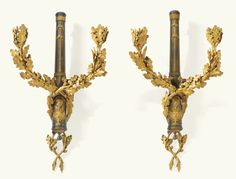AN IMPORTANT PAIR OF GILT-BRONZE AND patinated WALL LIGHTS WITH THE FRENCH ROYAL COAT OF ARMS, LOUIS XVI