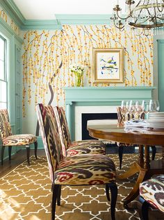 Portfolio   Katie Ridder Fairfield dining room Fromental wallpaper mint green color painted contrast trim moulding Madeline Weinrib rug brown ikat dining chairs