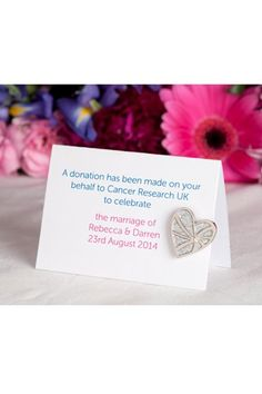 Amazing favour idea- charity donation instead of favours- here to cancer research. What a lovely thought.