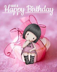 happy birthday, muñequita sobre un pastel con moño
