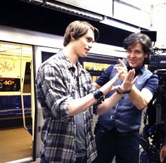 Here is JOHNNIE (played by Nicholas Galitzine) discussing a scene with Director @MichaelDamian during the shooting of @HighStrungMovie.