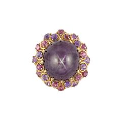 Gold, Star Ruby, Pink Tourmaline and Amethyst Ring One oval star ruby ap. 50.75 cts., ap. 22.6 dwt. Size 5, with inner guard