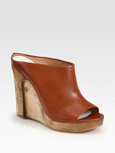 http://diamondsnap.com/maison-martin-margiela-leather-waxed-wooden-wedge-slides-p-2126.html