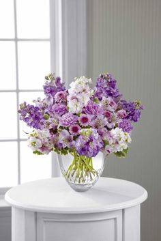 Decorating with the color purple Purple Flower Arrangements, Purple Flowers, Carnations, Lilies, Vera Wang, Blossoms, Photo Credit, Orchids, Home And Garden