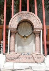 First Drinking Fountain    In 1859, The Metropolitan Drinking Fountain Association was set up by Samuel Gurney MP to offer free water and thus discourage alcohol – the only source of sterile drink for many. This first one – like many – was set up opposite a pub.  Set into the railings of St Sepulchre's Church, it still retains two cups on a chain.    Giltspur Street EC1  Tube: St Paul's