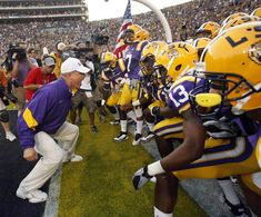 """The end of an era... I don't want to say goodbye to Les Miles AKA the """"Mad Hatter"""".   LSU head football Coach Les Miles leading the pack into the stadium on game day"""