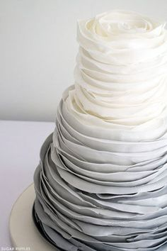 gray ombre ruffled wedding cake with rosette effect on top layer