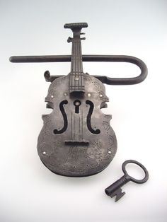 Violin padlock with key, ca. 1900