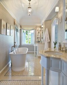 Gorgeous tile, natural light, a deep soaking tub and everything else you could possible want in a modern bathroom.