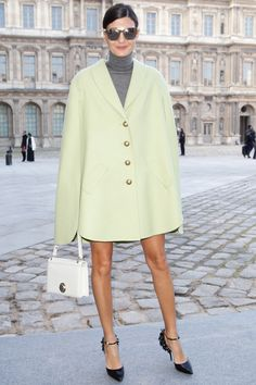 Giovanna is a vision in a lime green cape with those mile long stems sticking out. #PFW