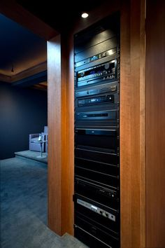 Home theater equipment rack built into wall
