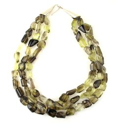 Multi strand semi-precious necklace.