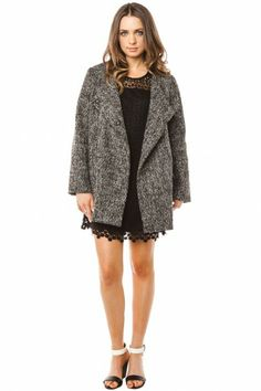 Rivendell Coat in Grey.  A minimalist coat in a cocoon-like shape. A flap covers the off-center buttoned placket, side pockets. Via Shop Sosie