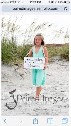 My daughter, Gabriella  with her here comes mommy sign for the beach wedding