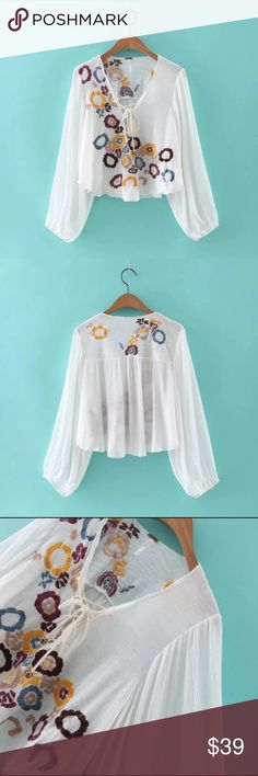 Embroidered bell shape top Material: cotton and rayon blended. Semi sheer Tops Blouses