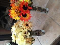 Dollar Store Floral Arrangements - about $5 each (including vase and rocks). I love being thrifty! Enjoy :)