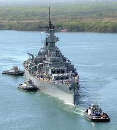 The battleship EX-USS Missouri (BB 63) returns to Ford Island after finishing scheduled repairs at Pearl Harbor Naval Shipyard.