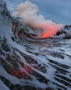 Amazing ocean moment, as waves & lava collide.