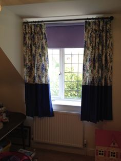 Goblet pleat interlined curtains with a contrast boarder.