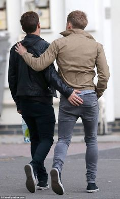 Cheeky! Tom Daley and Dustin Lance Black continue to be loved-up - as they proved when the winning diver, 21, got seriously hands-on with his 41 year-old partner in London on Monday