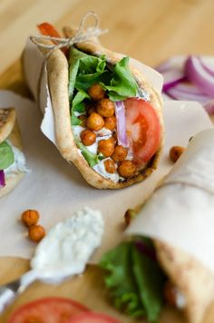 These Roasted Chickpea Gyros are a simple and delicious Mediterranean inspired wrap with refreshing tzatziki sauce.