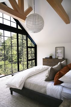 A spherical light fixture ties the proportions of the space together in the main bedroom. Save for a finished basement and a few walls above ground, this Ontario, Canada residence, designed by Nicholas Ancerl of Ancerl Studio, was built completely anew to fulfill the homeowner's wishes of a country-chic home. #interiordesign #architecture #homedecor Architecture Design, Cabinet D Architecture, Toronto Architecture, Black Window Frames, Black Windows, Ontario, Style Loft, Appartement Design, Interiores Design