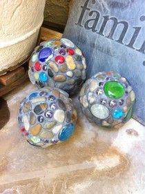 Garden Balls: made from some Styrofoam balls, grout, glue, stones, and various sized flat backed glass pieces. Easy enough to do with kids, and inexpensive too. These balls are waterproof and long-lasting.
