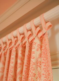 Curtains - bows at the top of ribbon hung curtain tabs