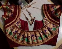 30 Latest Patch Work Saree Blouse Designs Patch work blouse designs are very attractive looking because of the work that they have. Patch work designs usually have layers of fabrics used to form different patterns and designs. And this sty… Patch Work Blouse Designs, Simple Blouse Designs, Stylish Blouse Design, Latest Blouse Designs, Saree Blouse Neck Designs, Bridal Blouse Designs, Pattern Blouses For Sarees, Net Blouses, Kurta Designs