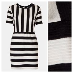 Topshop // Texture stripe shift dress Texture enhances bold stripes set at opposing angles on the sleeves, bodice and skirt for a maximum impact dress. Back zip closure. Cotton; machine wash. By Topshop. Sold out online. Lightweight and eye-catching! Topshop Dresses Mini