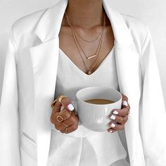 All white outfit, Layered necklace and a stack of trendy rings