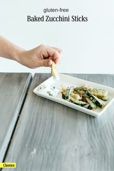 Coated in crushed cereal and seasoning, these fresh gluten-free zucchini sticks are a fun party appetizer.