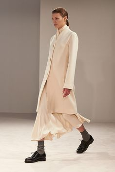 The Row Fall 2014 RTW. #TheRow #Fall2014 #NYFW winter ivory. tailored collarless jacket. whispy mid-calf skirt. derby shoes. slouchy socks. 40s. Edwardian/Revolutionary... hmmmm... a silhouette that appears in several decades...