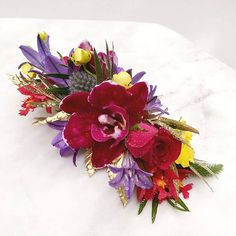 Flower comb, Theme- Beach wedding. Bright colours with a hint of gold sprayed leaves. Tropical vibe.   Colours- Orange ,yellow, reds, Pink, blue, purple, greens.